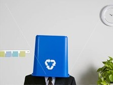 man with recycling bin on his head